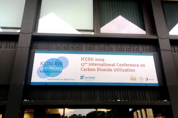 Th entrance with a poster to the ICCDU conference is visible.